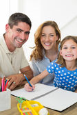 Parents assisting girl in drawing — Stock Photo