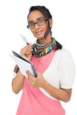 Portrait of a cool woman writing in notepad — Stock Photo
