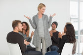Rehab group applauding happy woman standing up — Stock Photo