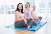 Pregnant women sitting in yoga class — Stock Photo