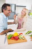 Couple with chopped vegetables — Stock Photo