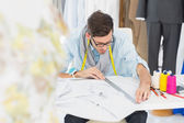 Male fashion designer working on his designs — Stock Photo