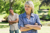 Upset couple in park — Stock Photo