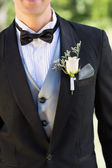 Groom wearing boutonniere — Stock Photo