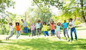 Friends jumping in park — Stock Photo