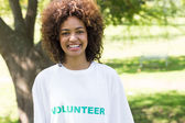 Confident female volunteer in park — Stock Photo