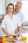 Smiling couple preparing a healthy dinner together — Stock Photo