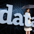 Businesswoman behind the word data — Stock Photo