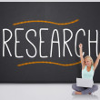 Cheering blonde with laptop against the word research — Stock Photo