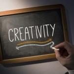 Hand writing Creativity on chalkboard — Stock Photo #42974023