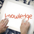 Hand touching knowledge on search bar on tablet screen — Stock Photo