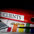 Clients on red business binder — Stock Photo #42976481