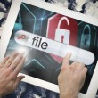 Hand touching file on search bar on tablet screen — Stock Photo