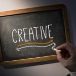 Hand writing Creative on chalkboard — Stock Photo #42978993