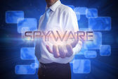 Businessman presenting the word - spyware — Stock Photo