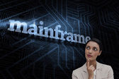 Word mainframe and smiling businesswoman — Stock Photo