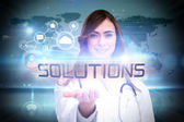 Word solutions and portrait of female nurse — Stock Photo
