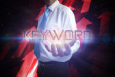 Businessman presenting the word keyword — Stock Photo