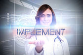 Word implement and portrait of female nurse — Stock Photo