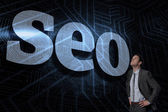 Seo against futuristic black and blue background — Stock Photo