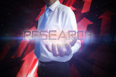 Businessman presenting the word - research — Stock Photo