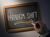 Hand writing Paradigm shift on chalkboard — Stock Photo
