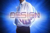 Businessman presenting the word - design — Stock Photo