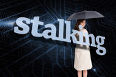 Businesswoman behind the word stalking — Stock Photo