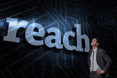 Reach against futuristic black and blue background — Stock Photo