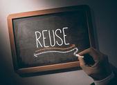 Hand writing Reuse on chalkboard — Stock Photo