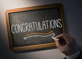 Hand writing Congratulations on chalkboard — Stock Photo