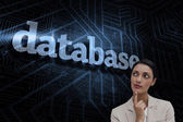 Word database and smiling businesswoman — Stock Photo