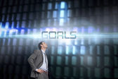 Goals against glowing codes on black background — Stock Photo