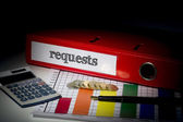 Requests on red business binder  — Stock Photo