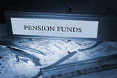 Pension funds on blue business binder  — Foto Stock