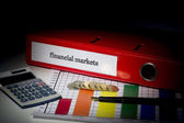 Financial markets on red business binder  — Stock Photo