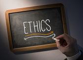 Hand writing Ethics on chalkboard — Stockfoto