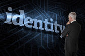 Word identity and thoughtful businessman — Stock Photo