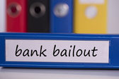 Bank bailout on blue business binder — Stock Photo