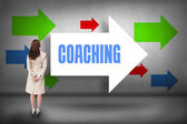 Coaching - against arrows pointing — Stock Photo