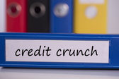 Credit crunch on blue business binder — Stock Photo