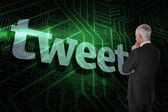 Word tweet and thoughtful businessman — Stock Photo
