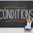 Cheering blonde with laptop against the word conditions — Stock Photo