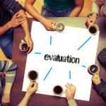 Students sitting around word evaluation — Stock Photo #42984555