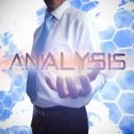 Businessman presenting the word analysis — Stock Photo