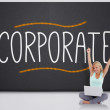 Cheering blonde with laptop against the word corporate — Stock Photo