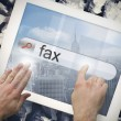 Hand touching fax on search bar on tablet screen — Stock Photo #42985049