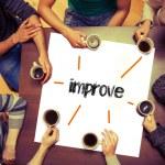 Students sitting around word improve — Stock Photo #42985419
