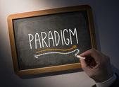 Hand writing Paradigm on chalkboard — Stock Photo