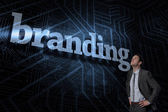 Branding against futuristic black and blue background — Stock Photo